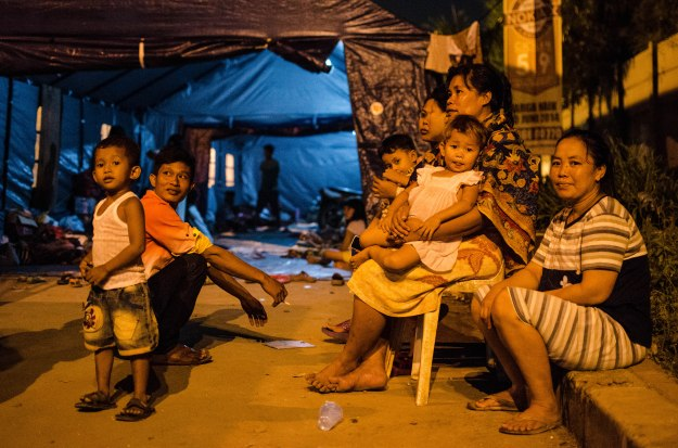 Homeless Muara Baru residents outside of PMI provided tents