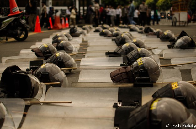 Riot gear ready for use outside KPU headquarters