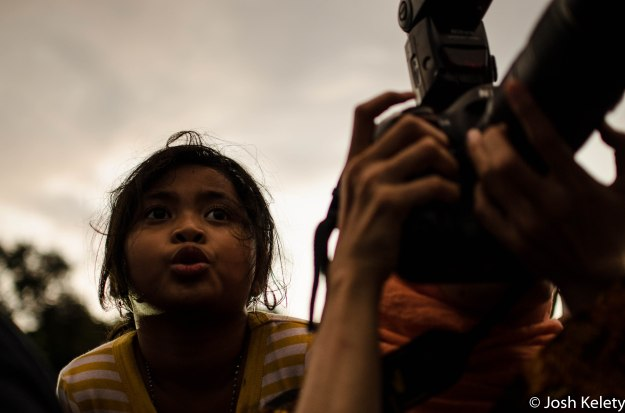 Young girl watches Jokowi while photographer gets the shot