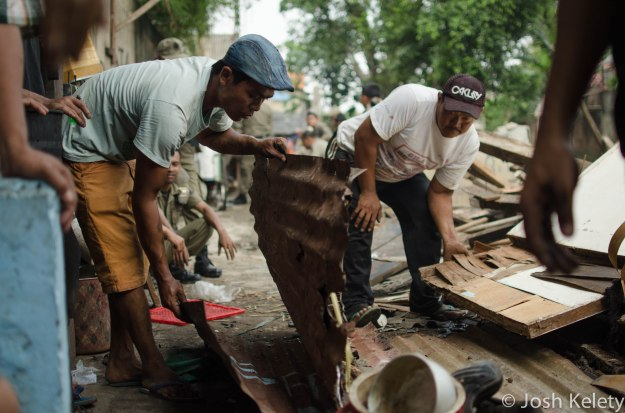 Mampang residents pick through the rubble