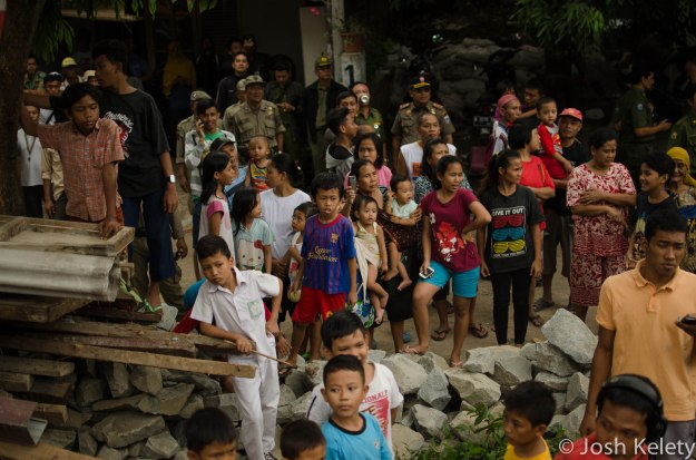 Residents watch home demolitions along Mampang river